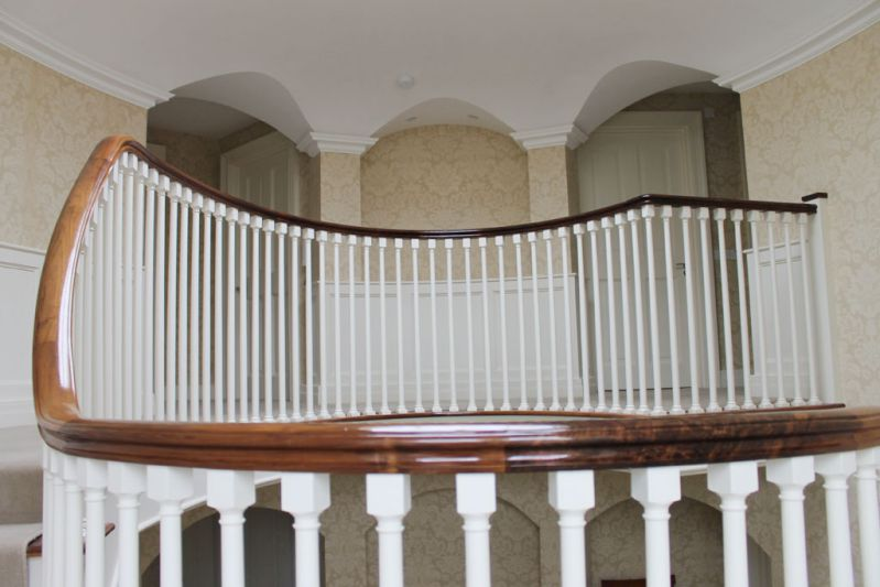curved walnut handrail