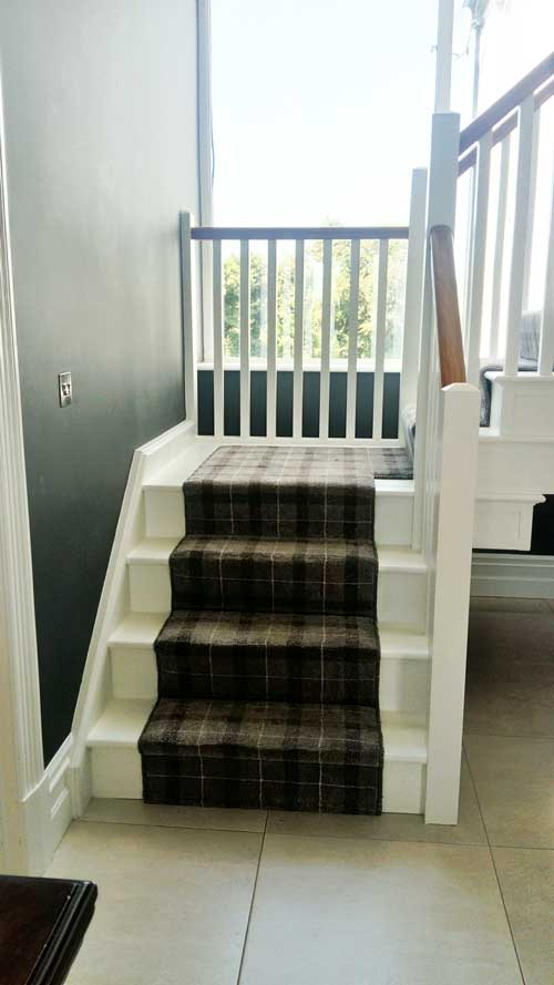 Painted red deal stairs with walnut handrail